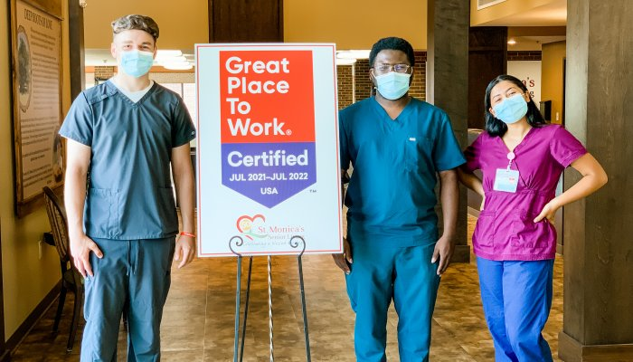 Staff with sign great place to work